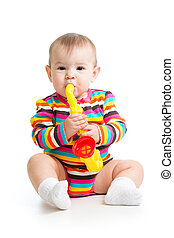 baby girl playing with musical toy