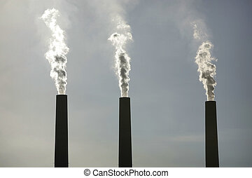 chimneys - three smoking chimneys of a power plant