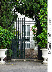 Vintage curved steel doors to the garden background