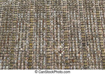 Aged big tile roof background photo