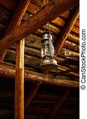 Oil lamp in old barn
