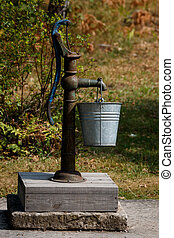 Water well - Old and rustic water well in countryside garden