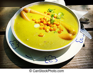 Thick homemade peas soup with German sausages....