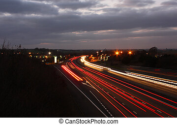 car light trails on a busy motorway at dusk