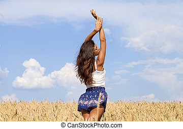 Young woman in a wheat golden field - Beautiful young woman...