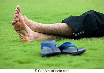 Foot without slippers - A person having relaxation over the...