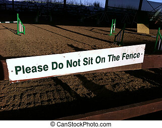 Please do not sit on the fence sign