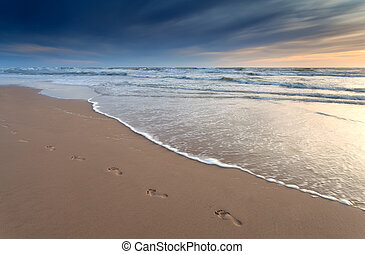 foot prints on sand beach at sunset, Zandvoort aan zee,...