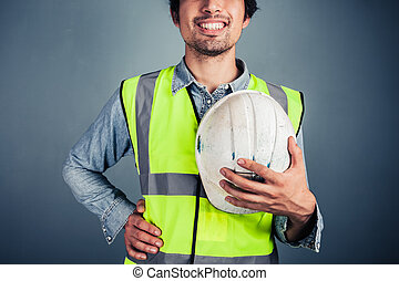 Happy young engineer with hard hat - A happy young engineer...