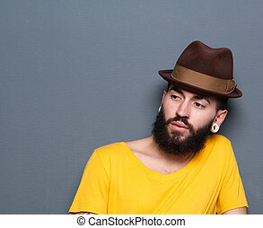 Young man with beard and piercings wearing hat - Portrait of...
