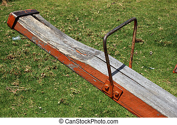 See Saw Seat - A wooden see saw seat on a childrens play...