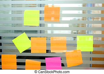 colourful blank post it on glass partition