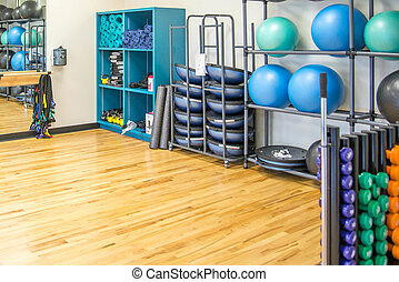 group exercise room with workout equipment - gym equipment...