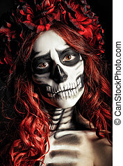 Closeup portrait of sad young girl with muertos makeup...