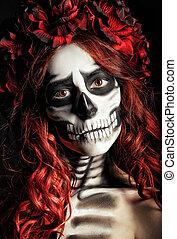 Closeup portrait of sad young girl with muertos makeup...