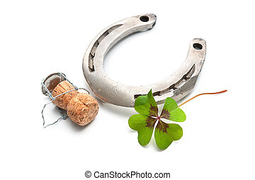 Horseshoe and champagne cork with a four leaf clover...