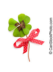 clover leaf with red ribbon isolated on white background