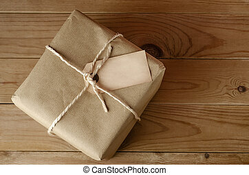 String Tied Parcel with Label - Overhead shot of a brown...
