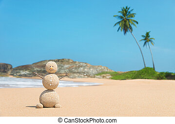 Sandy man at ocean beach against blue sky and palms - travel...