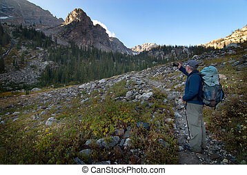 Man Hiking on Mountainside Photo with Smart Phone