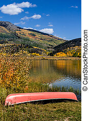 Fall in Steamboat Springs Colorado - Bright red canoe...
