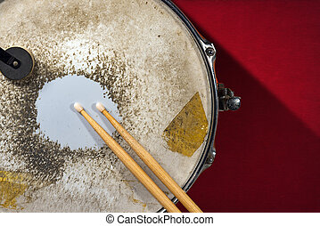 Old Metal Snare Drum with Drumsticks - Close up of metallic...