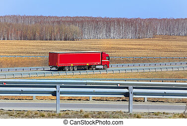 truck with trailer goes on the highway