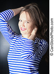 young woman in striped hoodie - smiling beautiful young...