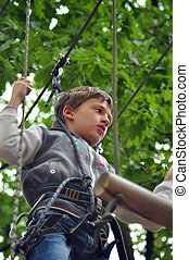child in a climbing adventure activity park