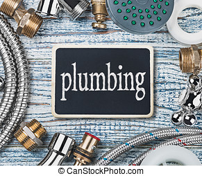 plumbing and aktsessoryes on wooden table background