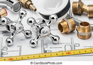 plumbing and tools lying on drawing