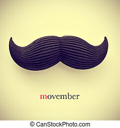movember - the word movember and a mustache on a beige...