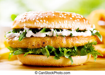 burger with chicken on wooden table