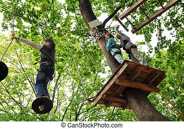children enjoying in a climbing adventure activity park