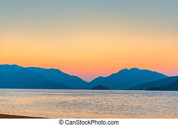 beautiful sunrise over the mountains over the sea