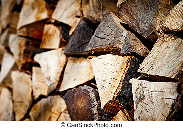 stack of chopped fire wood - fire wood background texture....