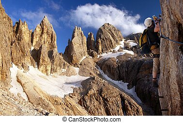 climber on via ferrata or klettersteig in Italy or Austria...