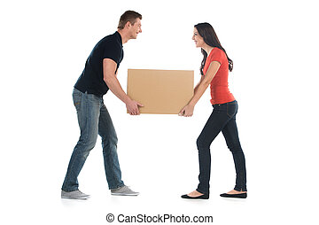 Beautiful young couple holding big heavy box man and woman...