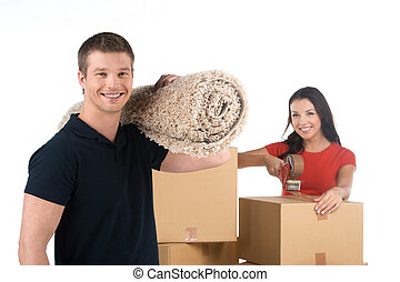 Portrait of smiling couple moving to new appartment man...