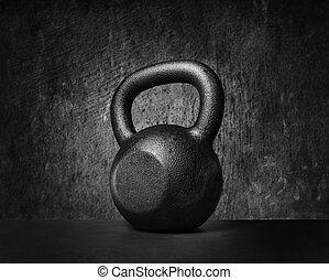 Kettlebell - Black and whit image of a rough and tough heavy...