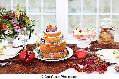 Dessert table for a wedding. Cake, cupcakes, sweetness and...
