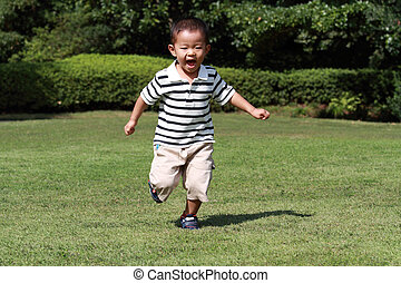 30   Japanese boy running on the grass