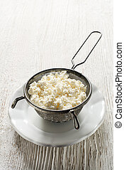 Cottage cheese - Making Fresh cottage cheese on wooden...