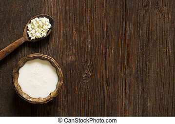 Kefir - Milk kefir grains on a wooden spoon overhead shoot