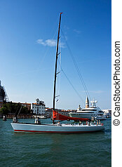 Sailing yacht in peripheral passage waters Venice Italy