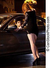 Prostitute and her client in car, vertical