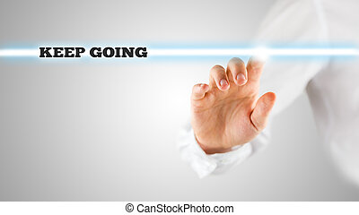 Hand Touching Keep Going Statement on Touch Screen -...