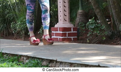 woman walking on a path in the tropics