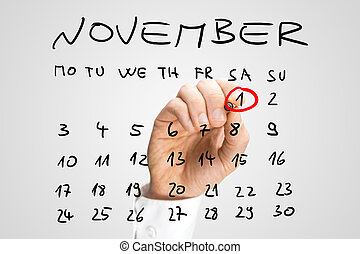 All Saints Day - Man ringing the date of 1st November for...