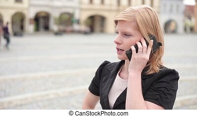 Businesswoman talking on the phone, being neutral